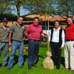 Patrick O'Leary (second from right) hands the FleetWatch gift tree to Nico Louw. With them from left are Frikkie Fourie, Innus Liebenberg and Johan Louw.