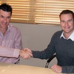 Rogan Brent, MD Manline Mega, (left) and Neil Henderson (CEO Barloworld Transport Solutions) sign the deal.