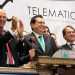 CEO of Mix Telematics, Stefan Joselowitz (centre), flanked by his management colleagues Richard Bruyns, chairman of MiX Telematics (left) and Charles Tasker, executive vice president of the company, stands on the podium overlooking the trading floor of the NYSE as he prepares to bang the gavel to signify the end of the day's trading.