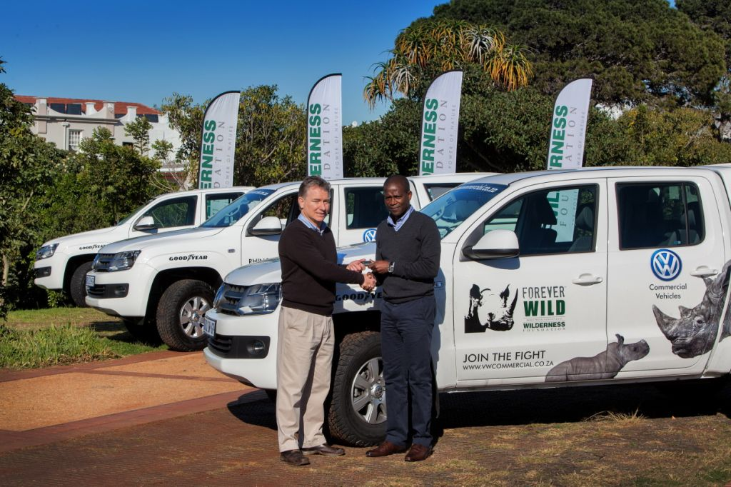 Matthew Norval, director: conservation at Wilderness Foundation (left) receives the keys of the six new Amarok double cabs from Andile Dlamini, manager: Volkswagen Brand Public Relations.