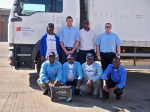 New diagnostics technology donated by Pullman Fleet Services is being sent to Zambia to help maintain commercial vehicle standards and improve road safety in the country. Pictured with Industrial Training Centre (ITC) staff are Tony Dobbins (standing, second left) and Tony Deus (standing, right) from Pullman Fleet Services.