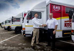 Jacques Carelse (left), managing director of UD Trucks Southern Africa – as now one of the main vehicle sponsor partners in this project - hands over the five new UD 40L units to Gawie du Toit, national transport manager for Shoprite.
