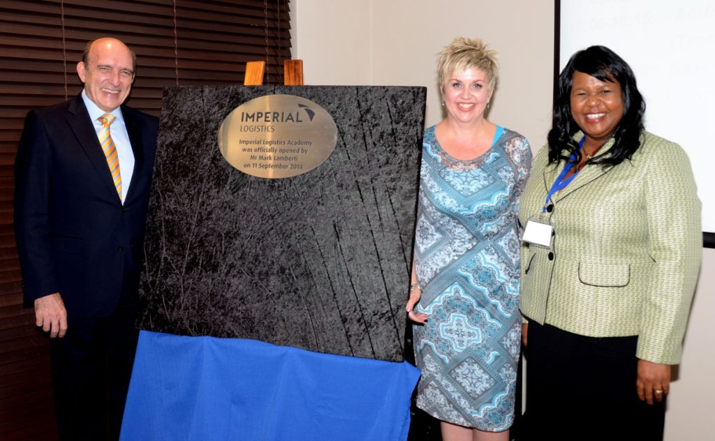 Unveiling the plaque at the official opening of the Imperial Logistics Academy in Germiston are, from left: Mark Lamberti, CEO of Imperial Holdings; Colette Wessels, training and development executive for Imperial; and Maphefo Anno Frempong, CEO of the Transport SETA.