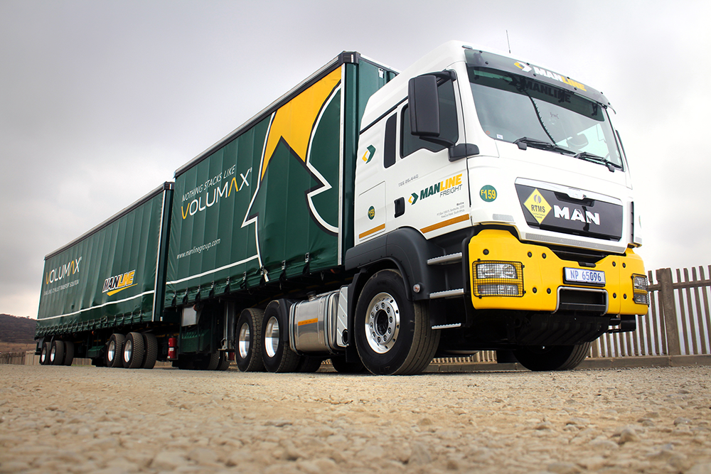Manline Freight exceeded the industry norm by scoring 97.4 in a recent Safety and Quality Assessment System (SQAS) audit. Note too the Road Transport Management System (RTMS) placard on the front of the rig. Best Practise does pay off.