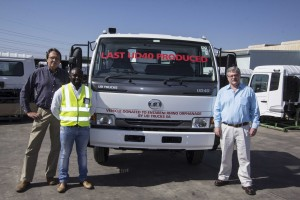 UD Trucks acting managing director, Rory Schulz (right), along with Aubrey Rambau, general manager of manufacturing, presents the last UD40 to Arrie van Deventer of the Legends Rhino Orphanage.