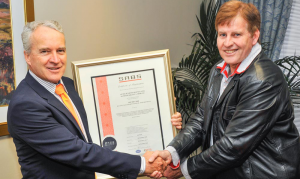 Harry Louw, Managing Director, Altech Netstar (left) receives the ISO9001:2008 certificate from Karel De Villiers, General Manager: Engineering Certification, SABS