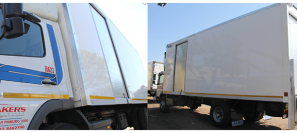 One of the new side loading vehicles manufactured for Bakers South Africa showing the roll-up door.