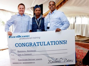 Clinton Savage (left), head of Mercedes-Benz Trucks and Rowlands Peters (right), head of FleetBoard South Africa, hand Marshall Hendricks his winner's prize – a trip to Germany – for coming first in the 2015 FleetBoard Drivers' League competition.