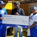 Engen CSI Manager Mntu Nduvane and Engen CSI co-ordinator Thandi Manqana hand over a cheque to ADM founder Jerry Ntimbane