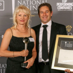 """Jo-Anne De Jager, Solutions Manager at Unitrans, receives the NBA Award from one of the judges, Themi Stergianos. Part of the citation read: """"Unitrans has shown an outstanding achievement in bettering its people, the planet and its profits through excellence."""""""