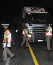 The reflective jackets of the cops were certainly bright , sometimes brighter than the reflective tape on the trucks.