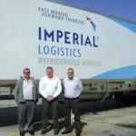 The test is on. From left: Peter Viljoen of Imperial Logistics, Gert van Rooyen of Serco, and Leonard Hyman, also of Imperial Logistics, in front of one of the test vehicles fitted with an ecoFridge unit.