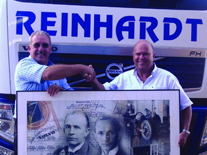 A delighted Derick Reinhardt (left) and Anders Lindblad show off the commemorative picture presented on the occasion of the delivery of the 1000th truck to the Reinhardt Group.