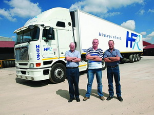 Happy relationship, from left: Pat Walsh, sales consultant, ELT Turfontein; Japie Meyer, managing director, HFR Refrigerated Transport, and Mark Langton, director, ELT Turfontein. The new trucks are fitted with the mid-roof cab with double sleeper bunks.