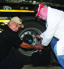 The right way - The extension to the valve on the inner tyre on this dual set of tyres made pressure checking easy for author of this article Dave Scott (right). However, having an extension is not the beginning and end. You actually have to check the pressure. This inner tyre was totally flat which resulted in the driver having to change the tyre after it was pointed out to him.