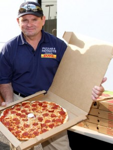 Mark Evans, founder of Pizzas 4 Patriots, with one of the 30 000 pizzas delivered to US servicemen in Afghanistan.