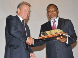 Garth Bolton, joint CEO of Cargo Carriers hands over a model truck to the Deputy President of South Africa, Kgalema Motlanthe, to keep trucking top of mind.