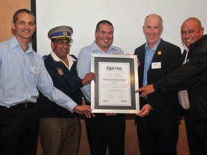 Ian Schutte, managing director of Triton Express (far left), and Eric Corbishley, joint CEO of Triton Express (centre), receive their RTMS Accreditation Certificate from Adrian van Tonder (far right), chairman of the RTMS steering committee and Paul Nordengen, member of the steering committee of the RTMS. With them is Wayne Minnaar, Chief Superintendent of the JMPD, who welcomes this form of self regulation as a route to improving safety on our roads.