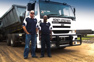 Honey Lotus Farm's business partners, Richard Burns and Elfie Mgidi in front of the UD 440 with more than a million kilometres on the clock. Mgidi was the UD 440's first driver.