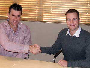 Rogan Brent, MD Manline Mega, (left) and Neil Henderson (CEO Barloworld Transport Solutions) sign the deal.
