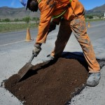 Workers on the Department of Roads and Public Works' Road Enterprise Development Programme ensure that the potholes are plugged or in some cases stripped and completely replaced and relayed.