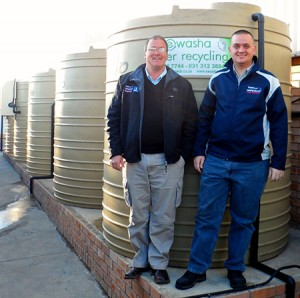 Nelis Fourie (right), business manager for IT & Facilities and Theo Muller, general manager of Special Projects at Imperial Cargo Solutions in front of the water treatment plant. Since March 2013, the water plant has provided a total of 286 144 litres of recycled water to the wash bay translating to a 64% water saving over the past four months.