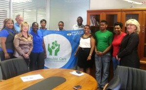 Louise Lindeque - CAIA - Responsible Care Manager, (second from left) and Ntokozo Mogorosi, CEO of NTP Logistics, (fourth from right) are joined with proud employees after the company signed a public pledge to practice the highest standards of safety. On the far right is Deidre Penfold, CAIA Executive Director Designate.