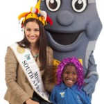 Miss South Africa, Nicole Flint, a Casual Day supporter with one of the children from the Alma School for the Disabled, which is one of the many beneficiaries of Casual Day.