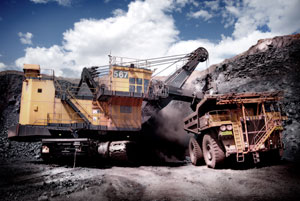 A huge loader loads iron ore onto a haul truck at Sishen Mine. The recent dispute between ArcelorMittal and Khumba Iron Ore brought to a head the sorry state of steel pricing in this country which is adversely affecting all industries, including trucking.