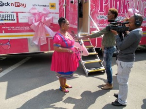 The recent handover of the Hino-based mobile mammography unit to PinkDrive was a high profile event in terms of support from central and local government. Here the Deputy Minister for Women, Children and People with Disabilities, Hendrietta Bogopane-Zulu, is seen being interviewed outside the vehicle.