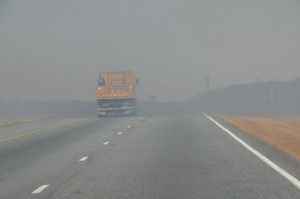 Road visibility is drastically reduced by smoke from veld fires during winter. Take extra care out there.