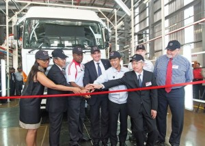 Taking part in the ribbon-cutting ceremony at the opening of the new Hino assembly plant in Prospecton are (from left): Ms Sindi Koyana, Non Executive Director, Toyota SA Motors (TSAM) Board Member; Masakazu Ichikawa, Chairman – Hino Japan; Bafana Dlomo, NUMSA Representative; Dr Johan van Zyl, President & CEO, TSAM; Motohiro Iida , Executive Vice President – Manufacturing and Manufacturing Support; Hitoshi Muramoto, Executive Vice President and Chief Coordinating Executive; Dave Finch, Senior Vice President - Manufacturing Group, TSAM; and Calvyn Hamman, Senior Vice President – Sales.