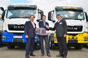 A happy day for Barloworld Transport Solutions and MAN Truck & Bus South Africa as the first batch of a total of 215 MAN TGS 26.440 6x4 truck tractors is handed over. From left: Bruce Dickson, CEO of MAN, Neil Henderson, CEO of Barloworld Transport Solutions and Geoff du Plessis, Executive Chairman, MAN Truck & Bus South Africa.