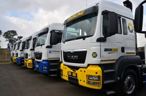 Looking resplendent in the Manline and Barloworld Transport Solutions livery is this line up of MAN TGS 26.440 6x4 truck tractors – the first of a total of 215 new units going into the Barloworld Transport Solutions and Manline fleets.