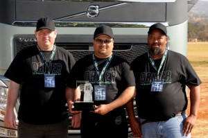 A more sedate Reggie Naidoo with his trophy and his fellow competitors - second placed Tshepo Leshope of Willowton Logistics (right) and third placed Willem Briedenhamm of Leon van Vuuren Bulk Logistics.
