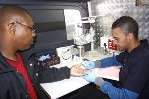 Driver Arthur Mogoba from HNE Cooling (left) undergoes one of the health checks by Nurse Gewin of Trucking Wellness. Checks for high blood pressure, cholesterol, diabetes, tuberculosis, BMI (Body Mass Index) and HIV/AIDS are undertaken.