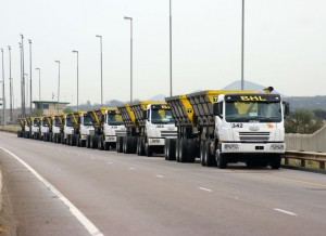 A line up of some of the FAW 100 FAW 28.380FT truck tractors hauling Afrit side-tippers for Buks Haulage Limited. BHL has extended its FAW fleet by a further 100 units which h are due for delivery through 2014 and into 2015.