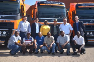 A first for the new Volvo FH into Africa: Back row from left: Malcolm Gush, general manager Volvo Trucks Sales; Sanjay Girdhar, general manager, Time Trucking Ltd; Godfrey Syalwindi, operations manager, Time Trucking Ltd; Umesh Patel, managing director, Time Trucking Ltd;  Aubrey Kavanagh, sales executive, Volvo Trucks; Torbjörn Christensson, President Volvo Group Southern Africa, with some of the happy drivers at the hand over the new trucks.