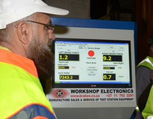 Ismail Vadi, Gauteng MEC for Roads and Transport, is shown a typical brake 'fail' when a rig was put on the brake roller tester.