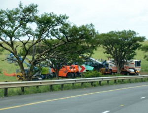 Road maintenance equipment takes a break over December under the shade of the trees alongside the N3 before starting work at full tilt this month on maintaining South Africa's busiest freight route.