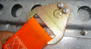 A close up photos showing the load strap attachment device