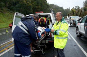 Philip Hull, seen here after attending to a crash victim, and his team of volunteers will be stationed at Van Reenen's Pass to help with any medical emergencies. They do not want to meet you – unless it's for a jovial cup of coffee when you stop for a break.