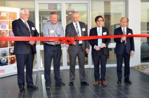 Cutting of the ribbon at the opening of Hino Isando are, from left, Calvyn Hamman, senior vice president sales and marketing, TSAM;  Patrick Arthur, dealer principal of Hino Isando; Ernie Trautmann, vice president of Hino SA; Junsuke Ando, general manager Europe and Africa Division, Hino Motors Limited; and Tetsuji Hitokata, managing director of Hino Motors Europe.