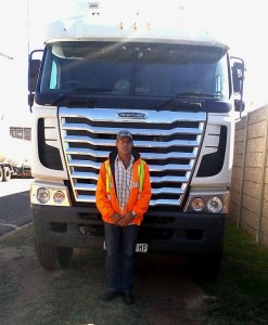 "Organiser Jan Bester in front of his beloved Freightliner: ""I'm a trucker to the bone but I have a soft spot for kids in need and just can't bear to see them going hungry or suffering in any way."
