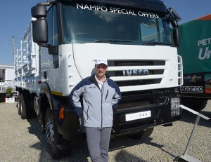 "Eamonn Parker, managing director of Iveco Southern Africa, in front of the New 682 which the company launched at the recent NAMPO show. This unit is aptly dressed for the occasion with a cattle body fitted. ""The New 682 competes above the Indian and Chinese products on a par with the Japanese products but below European products,"" says Parker."