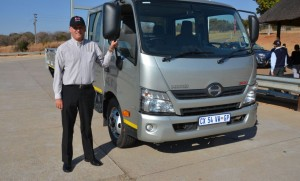 "Ernie Trautmann, vice president of Hino SA next to the Hino 815 with crew cab. The wheelbase of the 815 automatic transmission model has been shortened in reaction to feedback from customers and Hino dealers. ""The new additions to the Hino 300 range will make us even more competitive in the keenly-contested medium commercial vehicle market,"" he says."