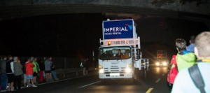 The Imperial Truck Rental trucks lead the pack.