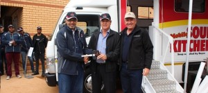 Head of FUSO Trucks Mr Naeem Hassim (left) and Mr Kobus van Zyl Executive Director of Daimler Trucks & Buses hand over the FUSO Canter LIFT to a representative of Shoprite.