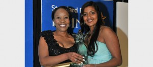 Rising Star winner of Transport, Logistics and Supply-Chain category, Connie Mdladla (left), MD of Khaas Logistics being presented her award by Melanie Naidoo, Human Resources Development Manager of Unitrans.