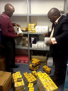 Botswana CID members inspect the counterfeit G.U.D. filters.